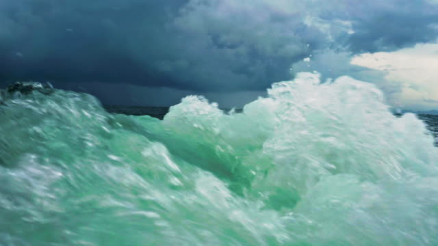 rough churning wake sea water behind boat during monsoon tropical storm - wake water stock videos & royalty-free footage