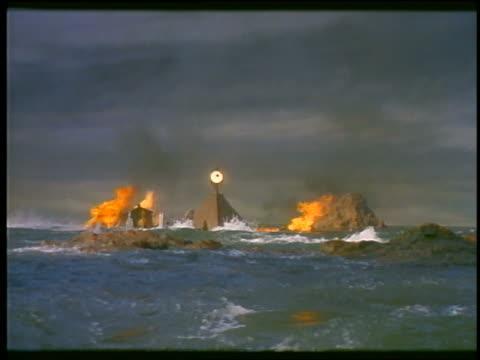 rough ocean / rocks fall to reveal pyramid exploding - whatif点の映像素材/bロール