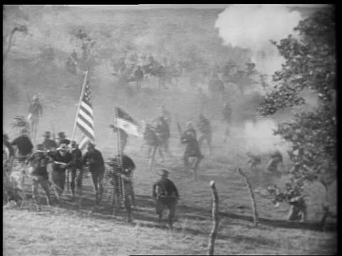 B/W 1898 REENACTMENT Rough Riders charging up San Juan Hill in Spanish-American war / documentary