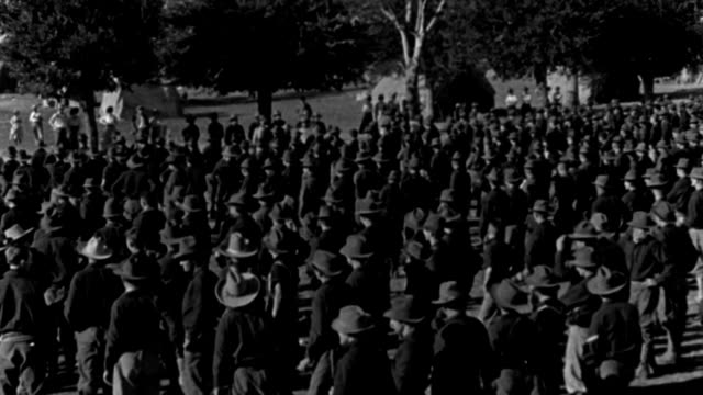 rough riders of the spanish-american war wave their hats and cheer during a speech by theodore roosevelt. - fade out stock videos & royalty-free footage