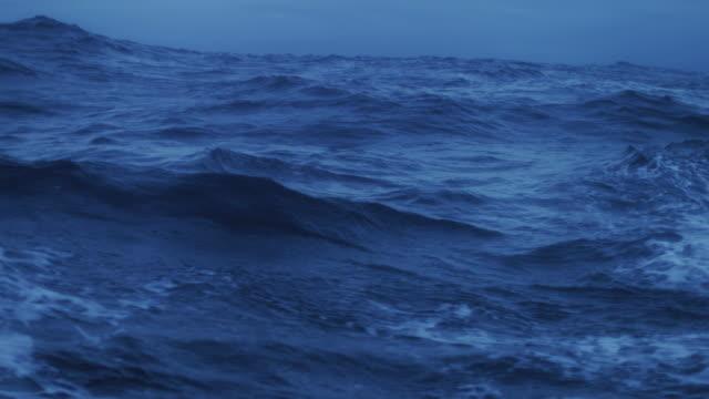 rough sea and waves crashing - scogliera video stock e b–roll