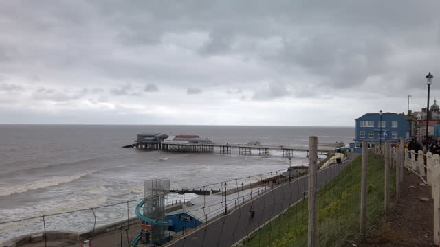 rough sea around the pier on the north sea coast at cromer norfolk england. - pier stock videos & royalty-free footage