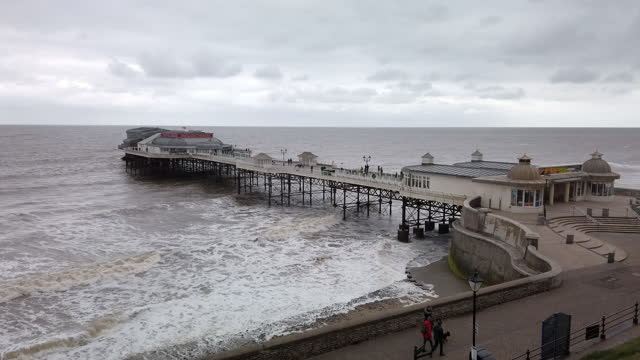 rough sea around the pier on the north sea coast at cromer norfolk england. - film moving image stock videos & royalty-free footage