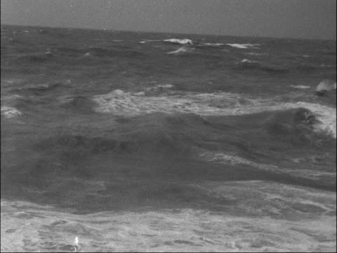 east sussex brighton/ ext/ various shots of waves breaking over seafront promenade/ rough sea with brighton pier in background/ sign on seafront... - east sussex stock videos & royalty-free footage