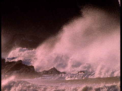 Rough surf pounds rocks on stormy coast, Ireland