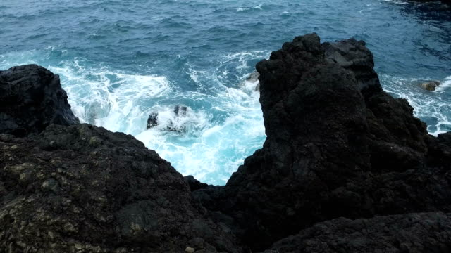 rough terrain from volcanic rock at coastline on maui - butte rocky outcrop stock videos & royalty-free footage
