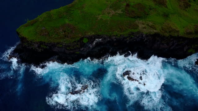Rough Water Breaking Against Base of Steep Maui Cliffside