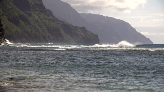 rough water on coast of kauai island - butte rocky outcrop stock videos & royalty-free footage