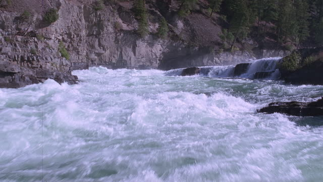 pan rough waters by the river rapids / united states - wildwasser fluss stock-videos und b-roll-filmmaterial