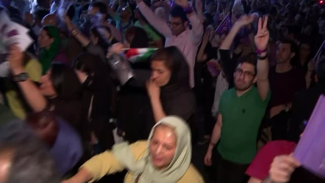Tehran Streets clogged with traffic and people after the victory in the presidential election of President Hassan Rouhani Various of crowds of...