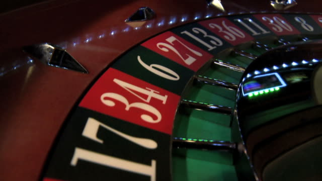 roulette wheel closeup - roulette stock videos and b-roll footage