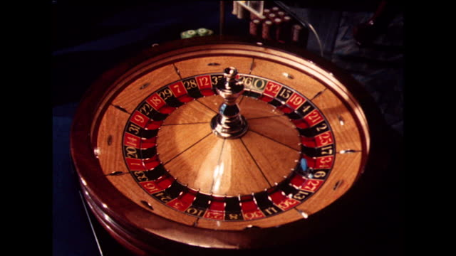 roulette wheel is uncovered and checked for accuracy; 1978 - roulette stock videos & royalty-free footage