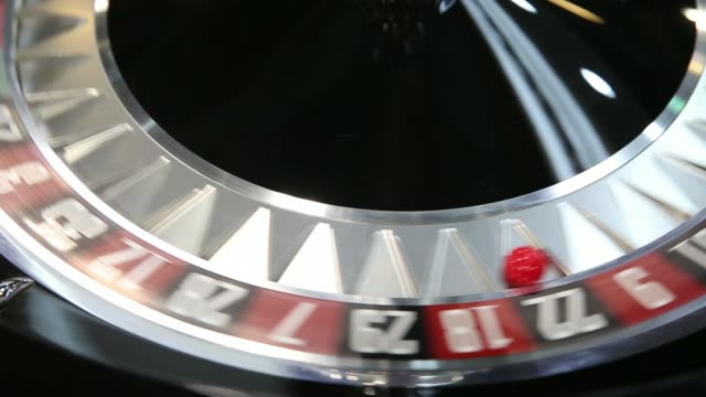 a roulette wheel sits on display at the cammegh ltd booth at the global gaming expo inside the venetian macao resort and casino operated by sands... - casino worker stock videos and b-roll footage