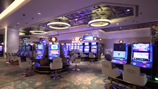 roulette wheels and slot machines stand on the gaming floor of the casino at the mgm cotai casino resort developed by mgm china holdings ltd in macau... - casino floor stock videos & royalty-free footage