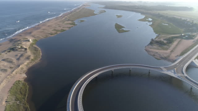 round bridge at the seashore - uruguay stock-videos und b-roll-filmmaterial