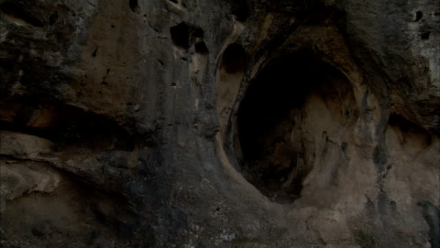 A round cave entrance in a rock face near Jerusalem. Available in HD.