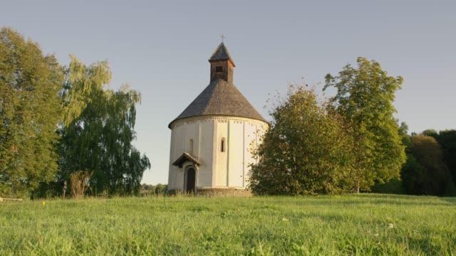 ms round church in tranquil, idyllic field, prekmurje, slovenia - prekmurje stock videos & royalty-free footage