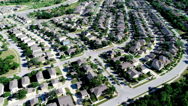 round rock texas suburb homes aerial drone view around curved modern community neighborhood - modern rock stock videos & royalty-free footage