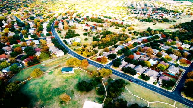 round rock , texas , usa fall foliage autumn suburb neighborhood aeiral drone view high above expanding housing development - modern rock stock videos & royalty-free footage