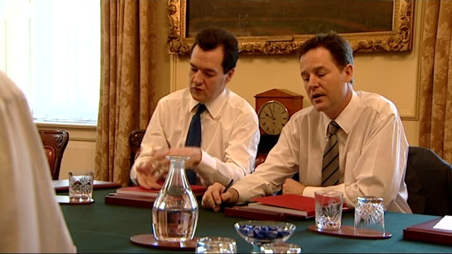london downing street int david cameron mp george osborne mp nick clegg mp and danny alexander mp in round table meeting budget 2010 red book on... - david cameron politician stock videos & royalty-free footage