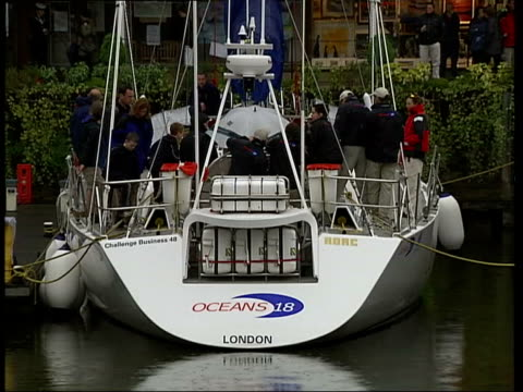 Round the World race competitors ITN St Katherine's Dock GV Yachts in dock Fiddler playing Folk band playing Crew members sorting sails Ducks Yacht...