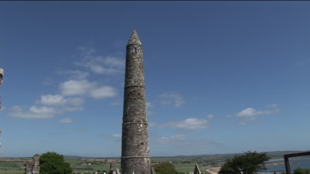 WS, Round tower of St Declan's church in rural landscape, Ardmore, County Waterford, Ireland