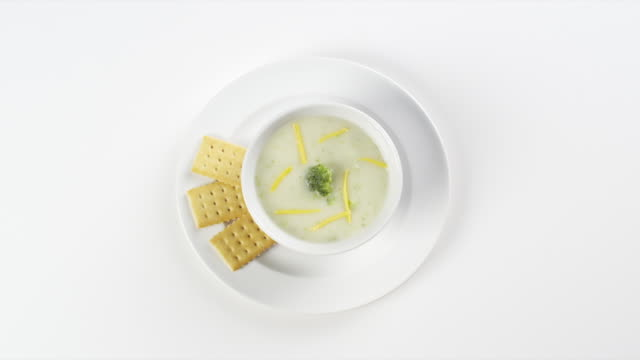 cu round white plate with potato soup and crackers / omaha, nebraska, united states - cracker stock videos and b-roll footage