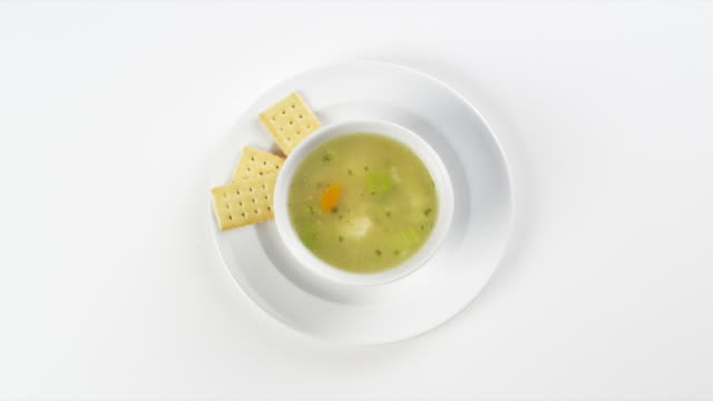 CU Round white plate with vegetable soup and crackers / Omaha, Nebraska, United States