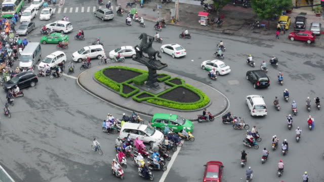 ws ha roundabout rush hour traffic and motorbikes in ho chi minh city - animal representation stock videos & royalty-free footage
