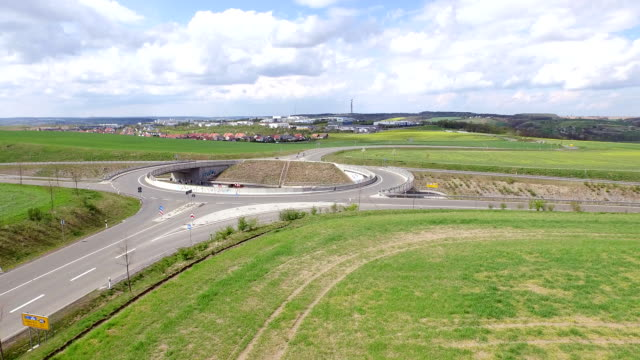 roundabout traffic aerial view - turingia video stock e b–roll