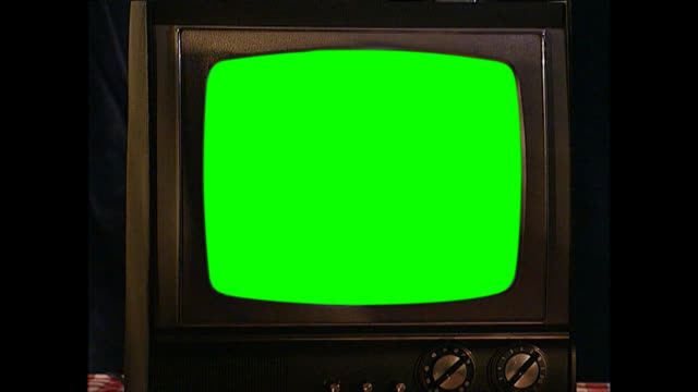 ms of rounded vintage tv set with green screen - old stock videos & royalty-free footage