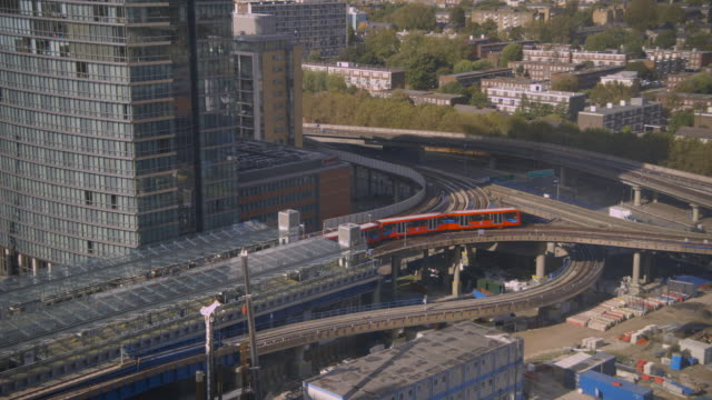 dlr rounds corner at a junction, canary wharf - london docklands stock videos & royalty-free footage