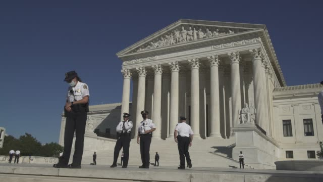 rounds of police guard the entrance to the u.s. supreme court on october 17, 2020 in washington, d.c. thousands of women gathered in washington d.c.... - us supreme court building stock videos & royalty-free footage
