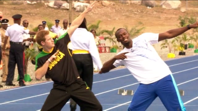roundup of prince harry's caribbean visit vox pops on harry's dancing sot prince harry and usain bolt both making bolt's trademark celebration... - posture stock videos and b-roll footage