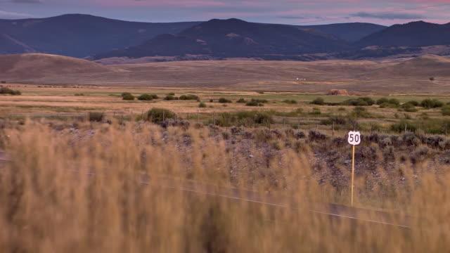 vídeos de stock, filmes e b-roll de route 50 across colorado farmland - gunnison