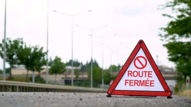 route fermée (road closed) - traffic sign - french - road closed sign stock videos & royalty-free footage