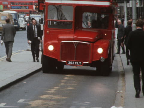 A Routemaster bus travels down a Piccadilly street