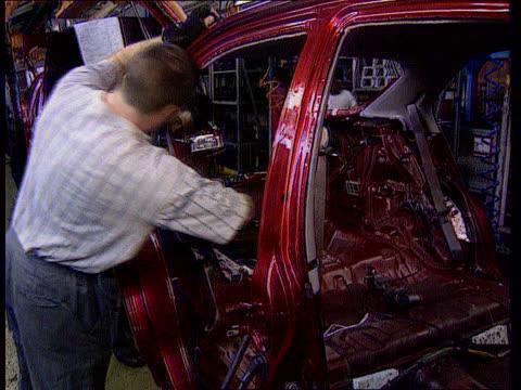 rover cars longbridge plant: byers visit; lib england: birmingham: ext cars on transporter away from rover cars longbridge plant int workers... - longbridge stock videos & royalty-free footage