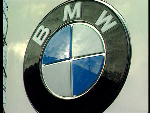 new model launched itn bmw badge at hq sign bmw hq - badge stock videos & royalty-free footage