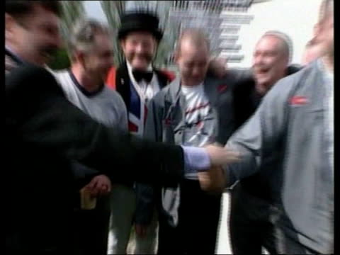 stephen byers; file / may 2000 longbridge: ext rover workers celebrating at time of takeover deal with phoenix john bull standing with placard... - longbridge stock videos & royalty-free footage