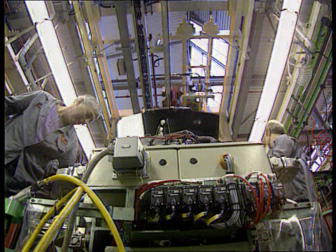 rover to suspend production lib england birmingham longbridge workers working on production line at rover plant - longbridge stock videos & royalty-free footage