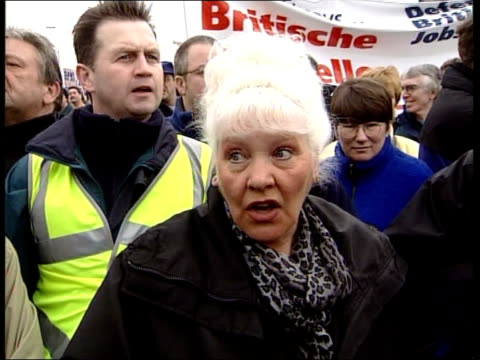 rover workers march over bmw; itn england: birmingham: ext gv rover workers & supporters towards with banners as protesting against bmw's decision to... - 30 seconds or greater stock-videos und b-roll-filmmaterial