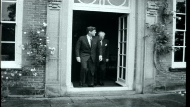 1963 The Year of Truth June 1963 ENGLAND Sussex Birch Grove Birth Grove Kennedy and Harold Macmillan pose for photocall outside house