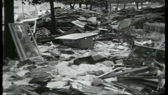 stockvideo's en b-roll-footage met a tale of two cities yugoslavia macedonia skopje earthquake damage to buildings reporter to camera clock stopped at time of earthquake more of damage... - quarter