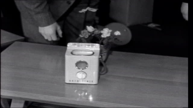 anniversary in tokyo vice president of big toy firm interview continued sot shows walking doll washing machine clockwork butterflies person using... - 1959 stock-videos und b-roll-filmmaterial