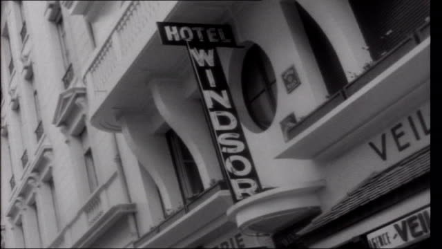 Basque Country Biarritz Old arches with modern flats above Sign for Victoria Hotel Sign for Hotel Edouard VII Sign for Hotel Windsor 'Hotel du...