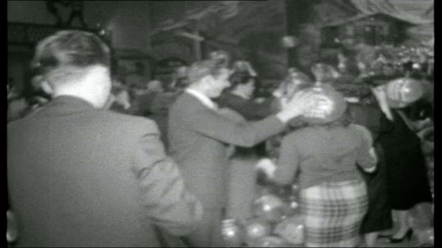 berlin city encircled couples dancing as balloons released from ceiling / people popping falling balloons tiergarten russian tank on plinth near... - 1950 1959 stock-videos und b-roll-filmmaterial