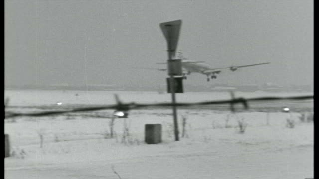 berlin city encircled plane coming in to land over graveyard / lorry at checkpoint entry to east berlin / warning sign / connell next to sign saying... - east berlin stock videos and b-roll footage