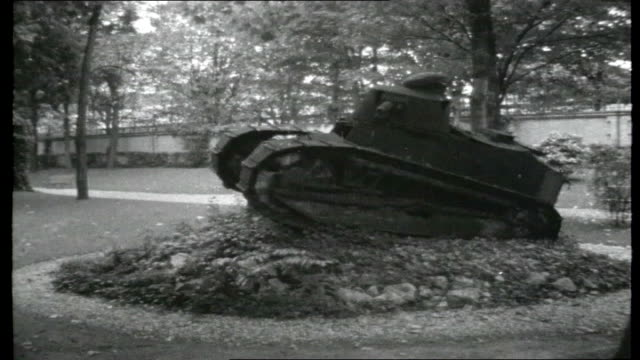 Billancourt Old Renault FT17 light tank on display Renault factory with name over entrance factory buildings