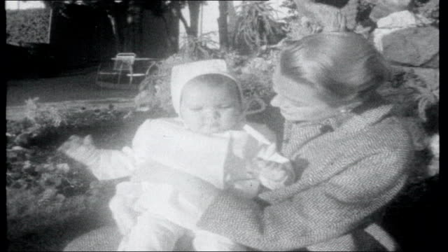 Birthday Album MONACO Princess Grace with baby daughter Princess Caroline in garden Citroen car along snowy road past woods driven by ITN film...